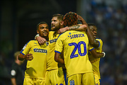 AFC Wimbledon Players Celebrate after Portsmouth Defender, Anton Walkes (2) scores an own goal to make it 1-2 during the Carabao Cup match between Portsmouth and AFC Wimbledon at Fratton Park, Portsmouth, England on 14 August 2018.