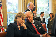 Secretary of State Hillary Rodham Clinton listens to Vice President Joseph Biden with George Mitchell in the background as President Barack Obama meets with Egyptian President Hosni Mubarak in the Oval Office on August 18, 2009.  photo by Dennis Brack