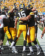August 31 2013: Iowa Hawkeyes quarterback Jake Rudock (15) celebrates with his teammates after a 6 yard touchdown run during the second quarter of the NCAA football game between the Northern Illinois Huskies and the Iowa Hawkeyes at Kinnick Stadium in Iowa City, Iowa on August 31, 2013. Northern Illinois defeated Iowa 30-27.