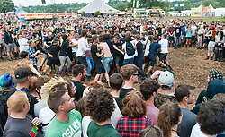 © Licensed to London News Pictures. 30/08/2015. Reading, UK. A mosh pit at Reading Festival during the performance of Feed the Rhino, Day 3 Sunday.  Photo credit: Richard Isaac/LNP