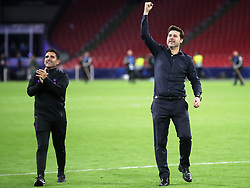 Tottenham Hotspur manager Mauricio Pochettino (right) and Jesus Perez celebrate after the final whistle during the UEFA Champions League Semi Final, second leg match at Johan Cruijff ArenA, Amsterdam.