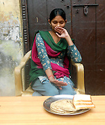 "EXCLUSIVE<br /> The Girl That Cannot Eat<br /> Manju Dharra longs to be able to sit down with her family and enjoy a humble meal of dal and rice or to savour the taste of the succulent flesh of a freshly picked mango. These are simple pleasures that the 25-year-old who lives in Sonipat, a town in India about 50km north east of the capital New Delhi, has been denied throughout her life: she cannot eat and lives off a liquid diet – largely made up of milk. She gets through a staggering four to five litres of milk each day and the family has even bought their own cow to be able to provide for her needs.<br /> ""Manju hasn't eaten solid food since she was born,"" explains Bhagwati Dharra, Manju's mother. ""She takes only fluids like milk tea water and sometimes juice. Mostly she takes milk, tea, buttermilk, water. If she eats solid food, she faces the problem of vomiting suddenly.""<br /> Manju has been diagnosed as suffering from achalasia, a condition with which food is prevented from being allowed to pass from the gullet through to the stomach.<br /> ""It feels good to drink liquid,"" Manju says. ""If I eat something then I throw up and I feel very, very bad. Now I feel fear when I look at solid food."" At 5 foot 5, she is above average in terms of height of Indian women, and manages to do daily household chores. Although she suffers some stomach pains and household chores, she otherwise appears relatively healthy.<br /> It took some time for the family to realise that Manju had a serious problem. She was on a diet of milk as a baby and her mother was not concerned at this stage.<br /> ""When she was two years old, like every child, we tried to give her some solids like rice, bread, biscuits but she cried again and again and threw up the food,"" says Mrs Dharra.<br /> At first Maju's parents believed that their child was a fussy eater or she was simply being mischievous by playing with her food and not wanting to eat it. But as time went on and Manju showed no signs of being able to hold her food down,"