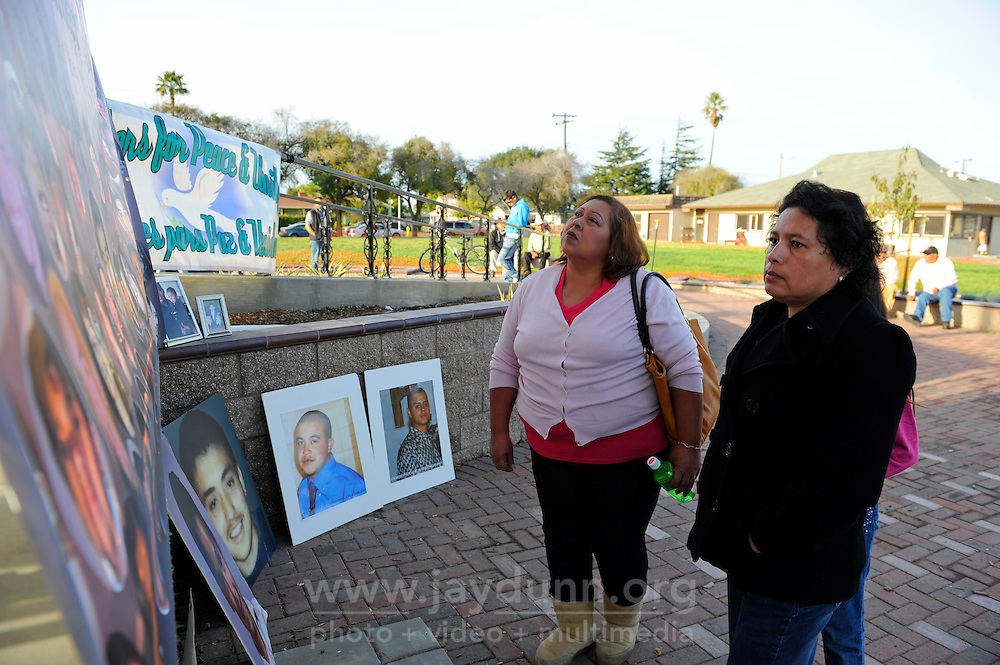 """Margarita Hernandez, left, and Maria Elena Rodriguez from King City pay their respects to the memory of Ricardo Salazar, the son of Ms. Hernandez who was a victim of violence. The group """"A Time for Grieving and Healing"""" unveiled a memorial boulder in Closter Park on Sunday in Salinas, dedicated to being """"a living memorial to our loved ones."""""""