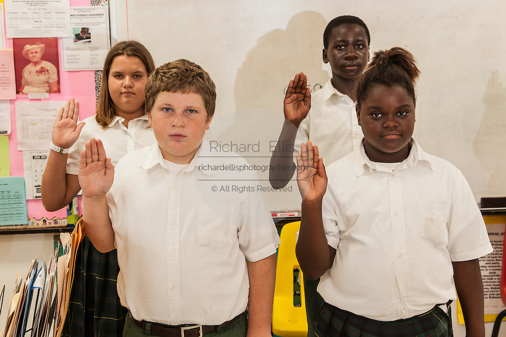 Bahamian school children practice the graduation oath in New Plymouth on Green Turtle Cay, Bahamas.