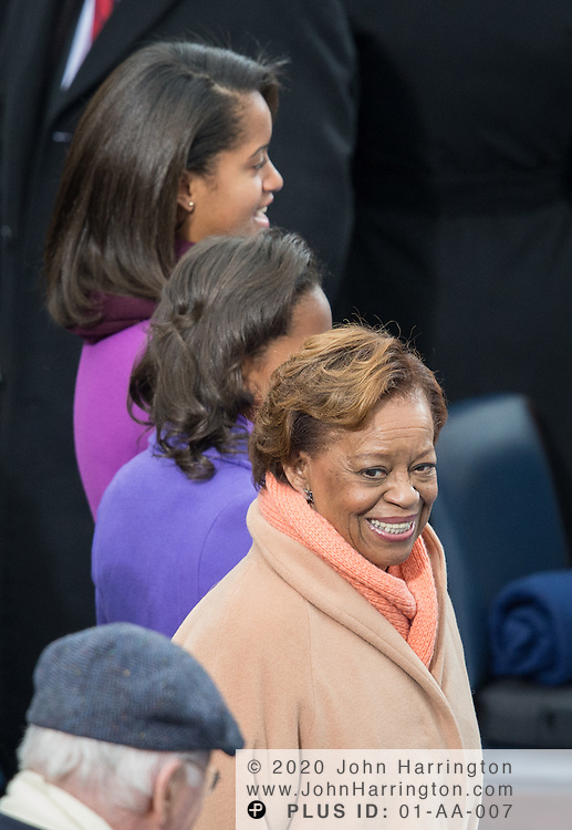 Sasha and Malia Obama with Marian Shields Robinson at the 57th Presidential Inauguration of President Barack Obama at the U.S. Capitol Building in Washington, DC January 21, 2013.