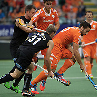 DEN HAAG - Rabobank Hockey World Cup<br /> 30 New Zealand - Netherlands<br /> Foto: Valentin Verga (orange, right) and Robbert Kemperman (orange, middle).<br /> COPYRIGHT FRANK UIJLENBROEK FFU PRESS AGENCY