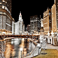 Chicago at night at Wabash Avenue Bridge (Irv Kupcinet Bridge) along the Chicago River with Trump International Hotel and Tower (401 North Wabash Avenue), Wrigley Building (410 North Michigan Avenue), Equitable Building (401 North Michigan Avenue), London Guarantee Building / Crain Communications Building (360 North Michigan) Mather Tower (75 East Wacker Drive), and Hotel 71 Building (71 East Wacker Drive). Photo is toned and high resolution.