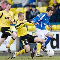 Livingston v St Johnstone.....14.03.09<br /> Kevin Moon is tackled by Joe Hamill<br /> Picture by Graeme Hart.<br /> Copyright Perthshire Picture Agency<br /> Tel: 01738 623350  Mobile: 07990 594431