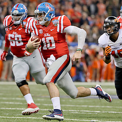 Jan 1, 2016; New Orleans, LA, USA; Mississippi Rebels quarterback Chad Kelly (10) runs with the ball during the second quarter in the 2016 Sugar Bowl against the Oklahoma State Cowboys at the Mercedes-Benz Superdome. Mandatory Credit: Derick E. Hingle-USA TODAY Sports