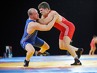Rami HIETANIEMI (FIN) in red v alo TOOM (EST) in blue, 96kg class, Greco Roman, The London Prepares Wrestling Olympic Test Event, ExCel Arena, London, England December 11, 2011.