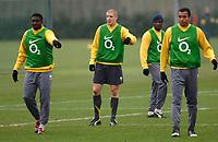Photo: Daniel Hambury.<br />Arsenal Training Session. 06/12/2005.<br />L-R Kolo Toure, Philippe Senderos, Lauren and Gilberto during training ahead of tomorrows Champions League game against Ajax.