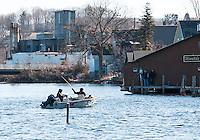 Anglers head into the Winnipesaukee River from Lake Winnisquam on opening day for landlocked fishing season Wednesday morning.  (Karen Bobotas/for the Laconia Daily Sun)