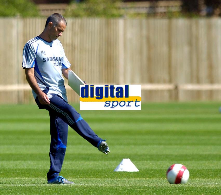 Photo: Daniel Hambury.<br />Chelsea Training Session. The Barclays Premiership. 24/07/2006.<br />Jose Mourinho kicks a ball during training.