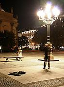 violinist busking at midnight, berlin, germany