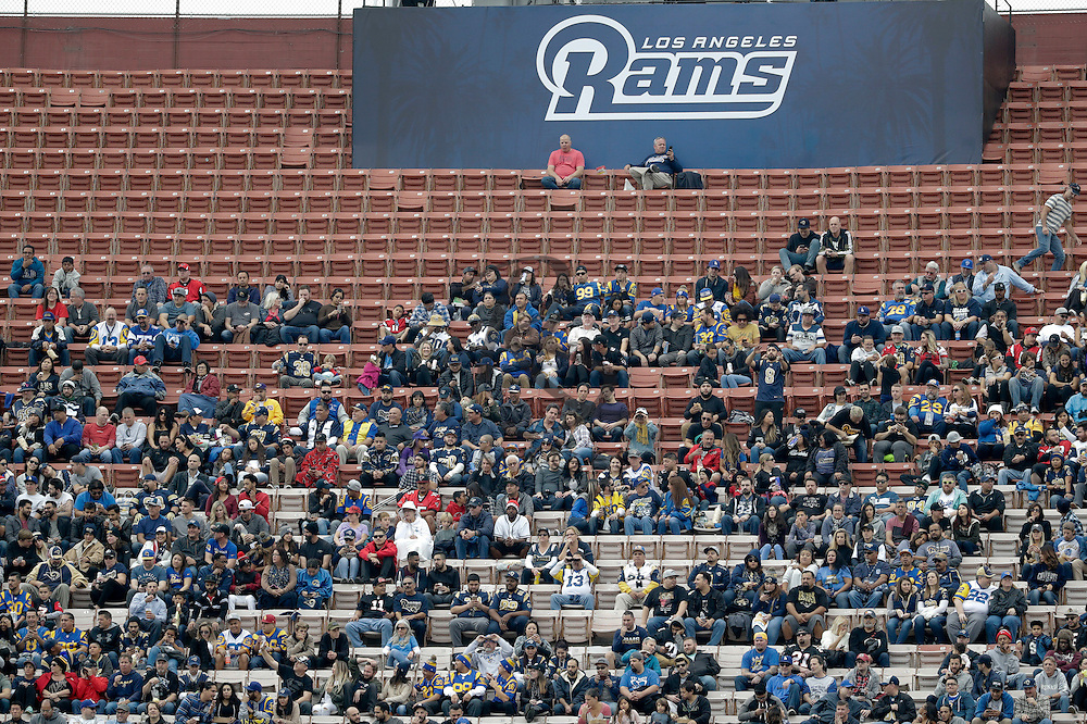 Fans sit near empty seats during the first half of an NFL football game between the Los Angeles Rams and the Atlanta Falcons Sunday, Dec. 11, 2016, in Los Angeles. (AP Photo/Rick Scuteri)