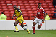 Burton Albion striker Lucas Akins (10) crosses the ball in front of Nottingham Forest defender Michael Mancienne (4) during the EFL Sky Bet Championship match between Nottingham Forest and Burton Albion at the City Ground, Nottingham, England on 21 October 2017. Photo by Richard Holmes.