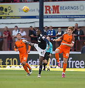 August 9th 2017, Dens Park, Dundee, Scotland; Scottish League Cup Second Round; Dundee versus Dundee United; Dundee's Glen Kamara heads the ball as Dundee United's Scott McDonald and Fraser Fyvie  watch