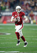 Arizona Cardinals quarterback Carson Palmer (3) scrambles while looking to pass in the fourth quarter during the NFL NFC Divisional round playoff football game against the Green Bay Packers on Saturday, Jan. 16, 2016 in Glendale, Ariz. The Cardinals won the game in overtime 26-20. (©Paul Anthony Spinelli)