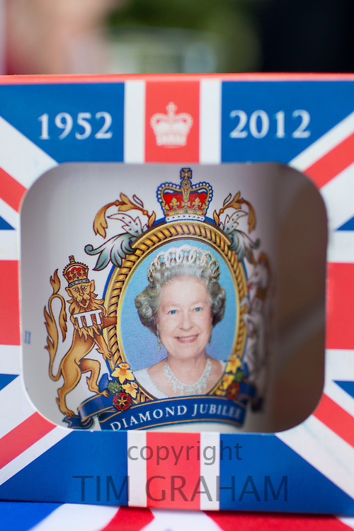 Commemorative mug with Union Jack flag given out at street party to celebrate the Queen's Diamond Jubilee in the UK