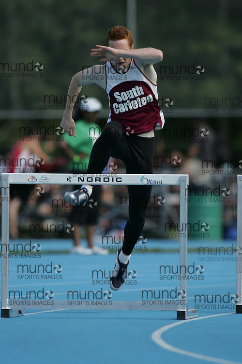 Stu Pearson competing in the senior boys 400m hurdles heat at the 2007 OFSAA Ontario High School Track and Field Championships in Ottawa.