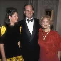Ronald S. Lauder, tehn U.S. Ambassador to Austria, stands between his wife, Jo Carole, left, and his mother, Estée Lauder (Josephine Esther Mentzer) in Lauder's Georgetown home in 1986.