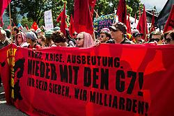 """06.06.2015, Garmisch Partenkirchen, GER, G7 Gipfeltreffen auf Schloss Elmau, Circa 5000 Menschen demonstrieren in Garmisch-Patenkirchen gegen den G7-Gipfel im benachbarten Elmau, im Bild Transparent mit der aufschrift """"Nieder mit dem G7 Gipfel"""" // uring Protest of the G7 opponents prior to the scheduled G7 summit which will be held from 7th to 8th June 2015 in Schloss Elmau near Garmisch Partenkirchen, Germany on 2015/06/06. EXPA Pictures © 2015, PhotoCredit: EXPA/ Eibner-Pressefoto/ Gehrling<br /> <br /> *****ATTENTION - OUT of GER*****"""