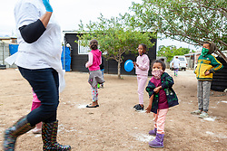 """Young children practise social distancing as they line up for food parcels at a """"Safe Zone"""" in Vanwyk'svlei, Wellington, Western Cape, South Africa.(Picture: JULIAN GOLDSWAIN)"""