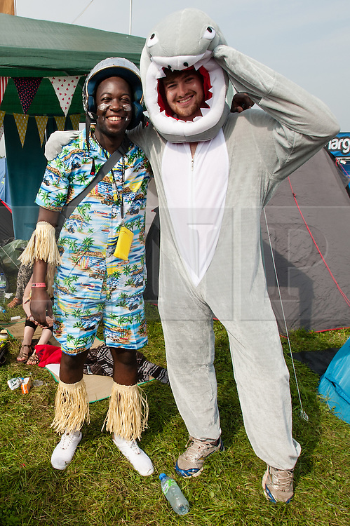 © Licensed to London News Pictures. 06/09/2014. Isle of Wight, UK. A group of festival goers at Bestival 2014 Day 3 Saturday get their outfits ready for the fancy dress day ahead - one is a shark and the other is a hula glitter ball.   Today is the festival's Fancy Dress Day - this year the theme is Desert Island Disco.  Festival goers spend the morning readying their costumes before the judging of the competition at 2pm.  This weekend's headliners include Chic featuring Nile Rodgers, Foals and Outcast.   Bestival is a four-day music festival held at the Robin Hill country park on the Isle of Wight, England. It has been held annually in late summer since 2004.    Photo credit : Richard Isaac/LNP