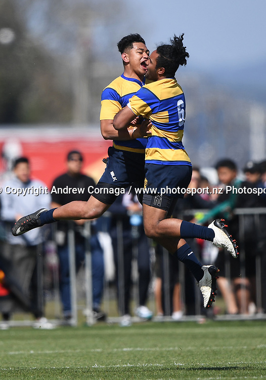 Marcellin's Agani Manson and Emanuel Tuimavave-Gerrard celebrate in mid air.<br /> Marcellin College v Haeata Community Campus.Development final.
