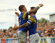 Tom Briscoe  of Leeds Rhinos celebrates scoring his 2nd try of the game with team mate Richie Myler (L) against Castleford Tigers during the Betfred Super League match at the Mend-A-Hose Jungle, Castleford<br /> Picture by Stephen Gaunt/Focus Images Ltd +447904 833202<br /> 08/07/2018
