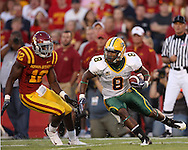 September 3, 2009: North Dakota State kick retuner D.J. McNorton (8) tries to allude Iowa State's Allen Bell (12) during the first half of the Iowa State Cyclones' 34-17 win over the North Dakota State Bison at Jack Trice Stadium in Ames, Iowa on September 3, 2009.