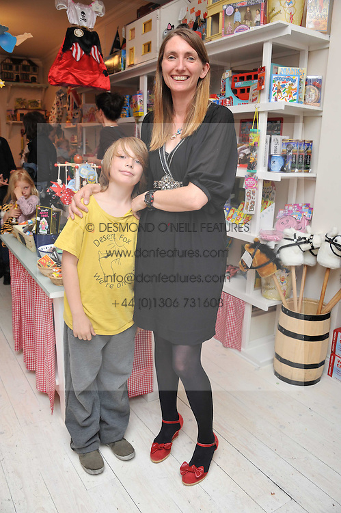 HONEY BOWDREY and her son LUDO ROSS at the opening of the new HoneyJam children's store at 2 Blenheim Crescent, London W11 on 7th July 2011.