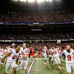 Jan 1, 2015; New Orleans, LA, USA; Ohio State Buckeyes players erupt from the bench in celebration after defeating the against the Alabama Crimson Tide in the 2015 Sugar Bowl at Mercedes-Benz Superdome. Ohio State defeated Alabama 42-35. Mandatory Credit: Derick E. Hingle-USA TODAY Sports