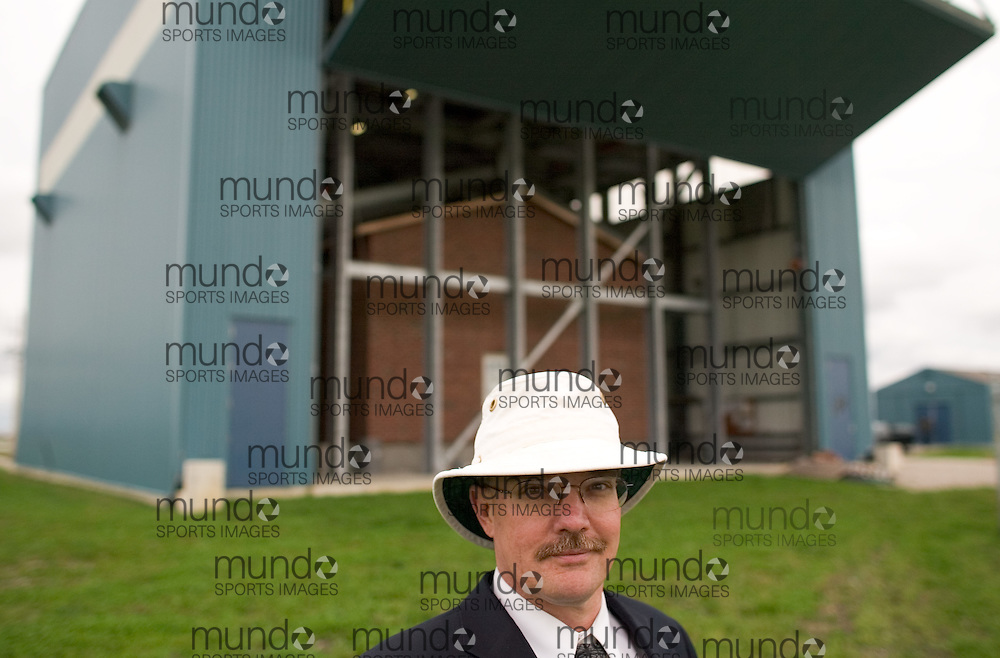 London, Ontario ---06/9/28--- Professor Mike Bartlett stands in front of the Three Little Pigs facility; a two story, suburban-style test house inside a large hanger like building near the airport in London, Ontario. The facility will test the forces applied to structures in a simulated hurricane..GEOFF ROBINS The Globe and Mail<br />