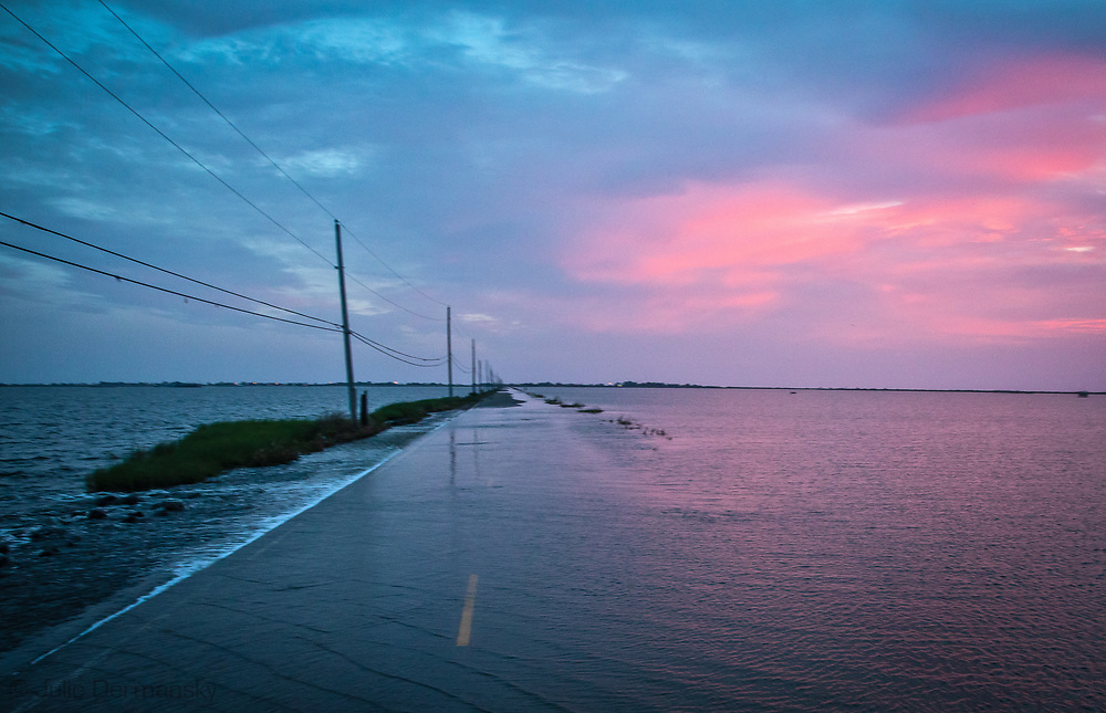 Island road leading to  Isle de Jean Charles  covered in flood water.
