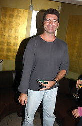 SIMON CAlLOW at a party to celebrate the publication of Dot.Homme by Jane Moore held at Embassy Club, Old Compton Street, London on 14th July 2004.