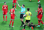 Adelaide United's Marcelo Carrusca is yellow carded for his trip tackle on Phoenix' Roly Bonevacia during the Round 22 A-League football match - Wellington Phoenix V Adelaide United at Westpac Stadium, Wellington. Saturday 5th March 2016. Copyright Photo.: Grant Down / www.photosport.nz
