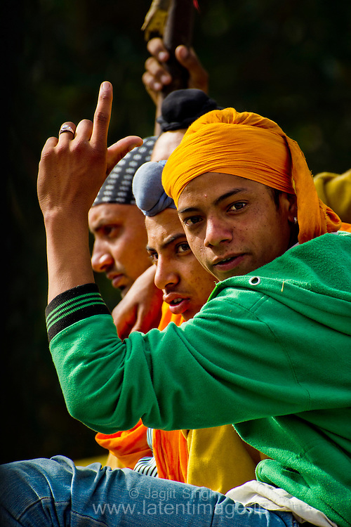 A group of boys are at the festival to witness the glory of the sikh tradition.
