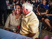 """14 FEBRUARY 2017 - BANGKOK, THAILAND: A couple after getting married in the Bang Rak district in Bangkok. Bang Rak is a popular neighborhood for weddings in Bangkok because it translates as """"Village of Love."""" (Bang translates as village, Rak translates as love.) Hundreds of couples get married in the district on Valentine's Day, which, despite its Catholic origins, is widely celebrated in Thailand.      PHOTO BY JACK KURTZ"""