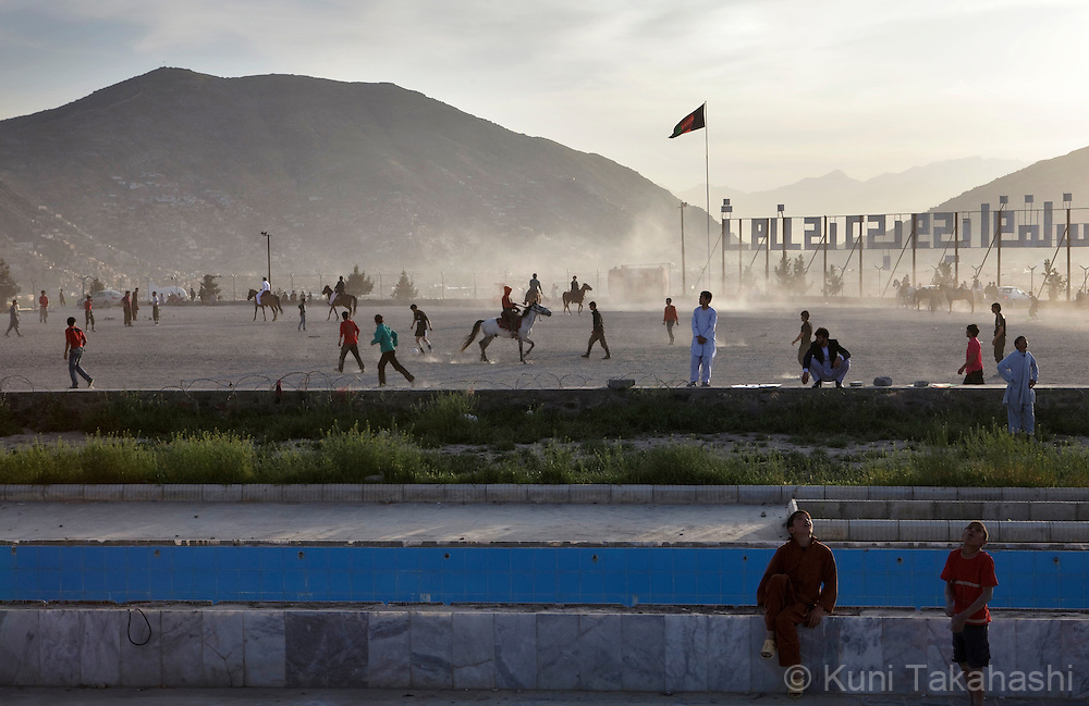(Kabul Afghanistan - May 4, 2012).Young people play on top of the hill in Kabul, Afghanistan on May 4, 2012. After years of war, severe poverty and poor security, Afghanistan is considered to be among the most dangerous places for children..(Photo by Kuni Takahashi)