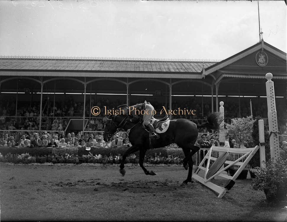 """04/08/1960<br /> 08/04/1960<br /> 04 August 1960<br /> R.D.S Horse Show Dublin (Thursday). Lieut. E.P. O'Donohue, (Ireland) nearly comes a cropper on """"Cill an Fhail"""" having knocked the """"railway gate"""" in the Baylon Perpetual Challenge International Trophy at the Dublin Horse Show."""