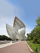 Fondation Louis Vuitton, an art museum and cultural centre designed by Frank Gehry, b. 1929, and built 2008-14, next to the Jardin d'Acclimatation in the Bois de Boulogne, in the 16th arrondissement of Paris, France. The building resembles the sails of a boat and houses 11 galleries, an auditorium seating 350 and roof terraces. Picture by Manuel Cohen