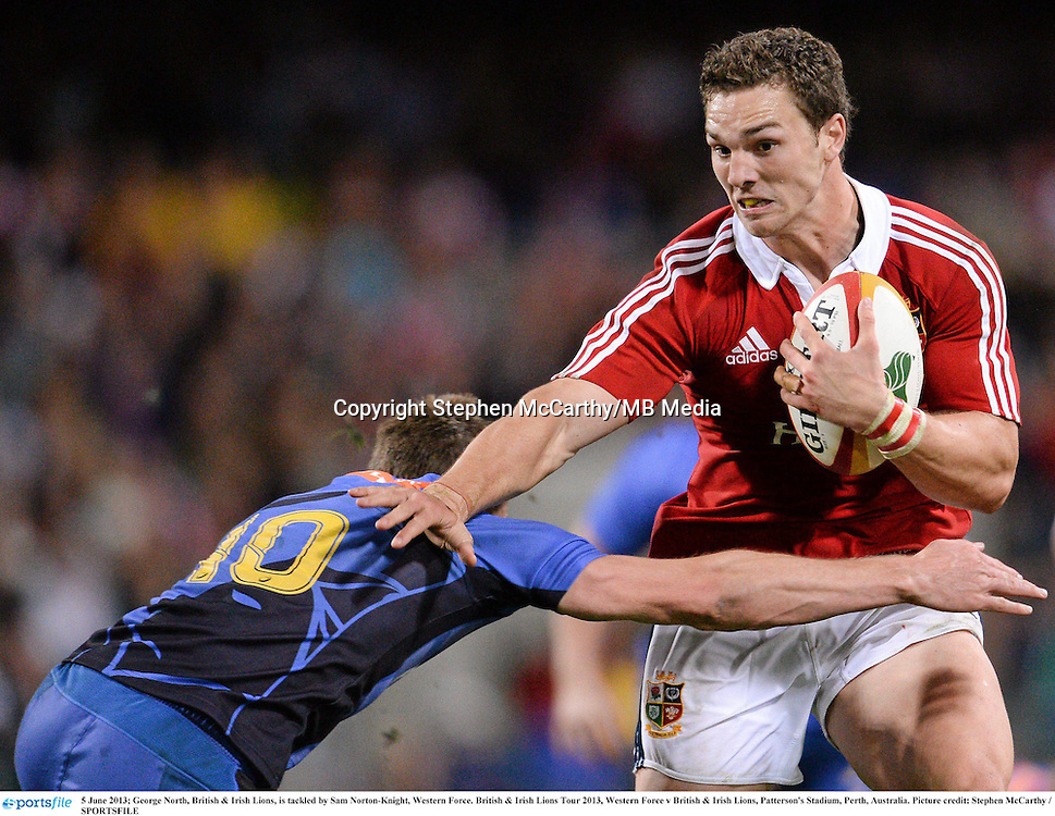 5 June 2013; George North, British & Irish Lions, is tackled by Sam Norton-Knight, Western Force. British & Irish Lions Tour 2013, Western Force v British & Irish Lions, Patterson's Stadium, Perth, Australia. Picture credit: Stephen McCarthy / SPORTSFILE