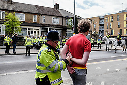 Arrests are made as anti-fascists gather to protest against a march held by the English Defence League. Walthamstow London May 2015
