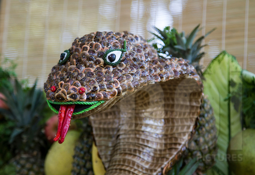 Detail of snake head created from bits and pieces of food, Ho Chi Minh City, Vietnam, Southeast Asia