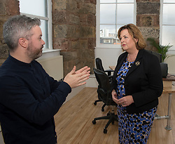 Culture Secretary Fiona Hyslop visits the studios of Blazing Griffin, a film & tv production and post production company, who have just received £200,000 GBP funding to enhance their facilities in Glasgow. She is pictured with David Frew of Blazing Griffin, in one of the company's purpose built editing suites.<br /> © Dave Johnston/ EEm