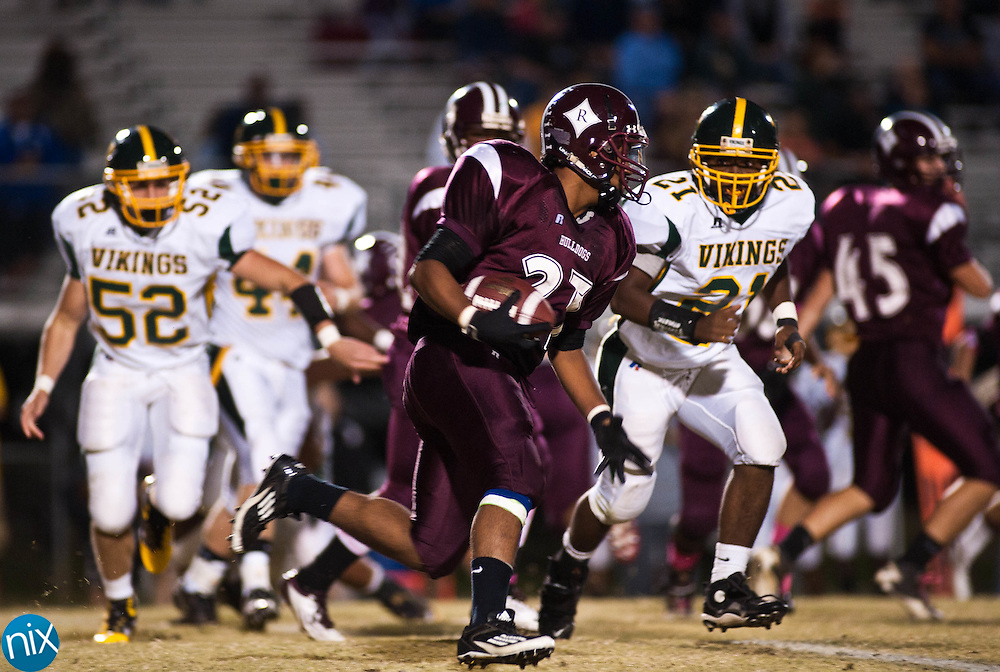 Jay M. Robinson's Darien Williams carries the ball against Central Cabarrus Friday night in Concord. (Photo by James Nix)