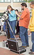 New Paltz, New York - A woman looks through a filtered telescope to watch the Transit o Venus on the State University of New Paltz campus on June 5, 2012. Venus crossed in front of the sun and was visible as a small black disk. The next Venus transit will not occur until 2117.