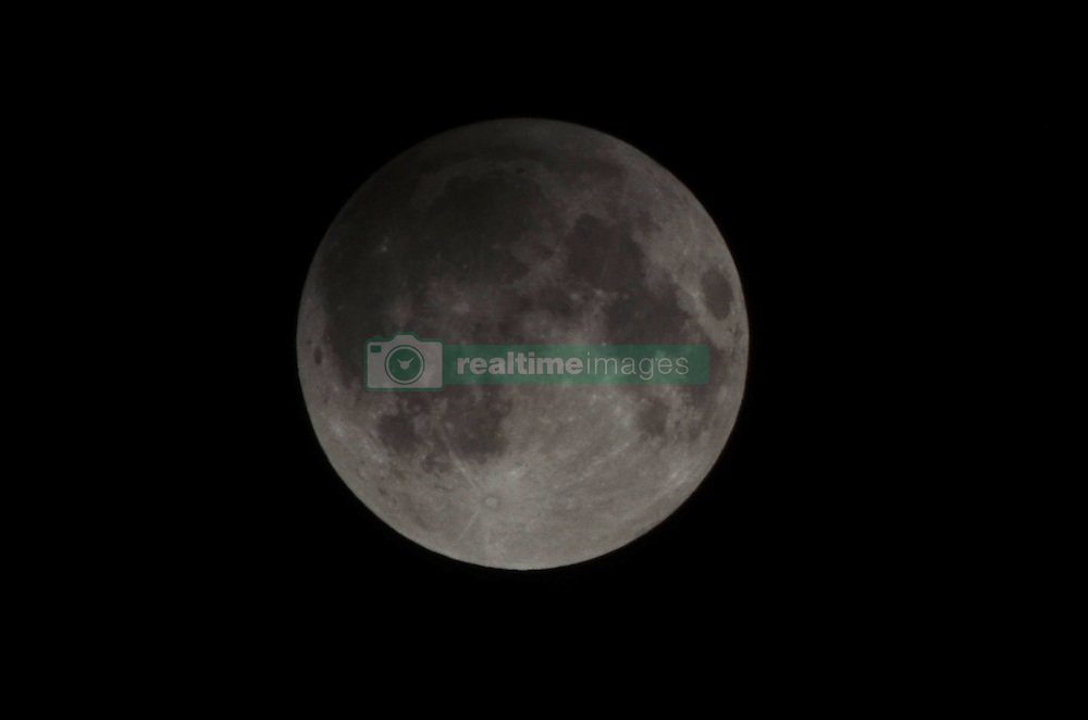 September 16, 2016 - Lahore, Punjab, Pakistan - A view of the full Lunar Eclipse (Chand Grahan) in lahore night. Pakistan will witness penumbral moon eclipse (Chand Grahan)..The lunar eclipse or chand grahan will be notice in different cities of Pakistan including Lahore, Karachi, Multan and other cities.The duration of the Lunar Eclipse in Pakistan will be of 3 hours. The Pakistan Meteorological Department (PMD) said that the lunar eclipse will occur in the country starting from 09:55 pm and will last nearly at 1:54 PM. (Credit Image: © Rana Sajid Hussain/Pacific Press via ZUMA Wire)