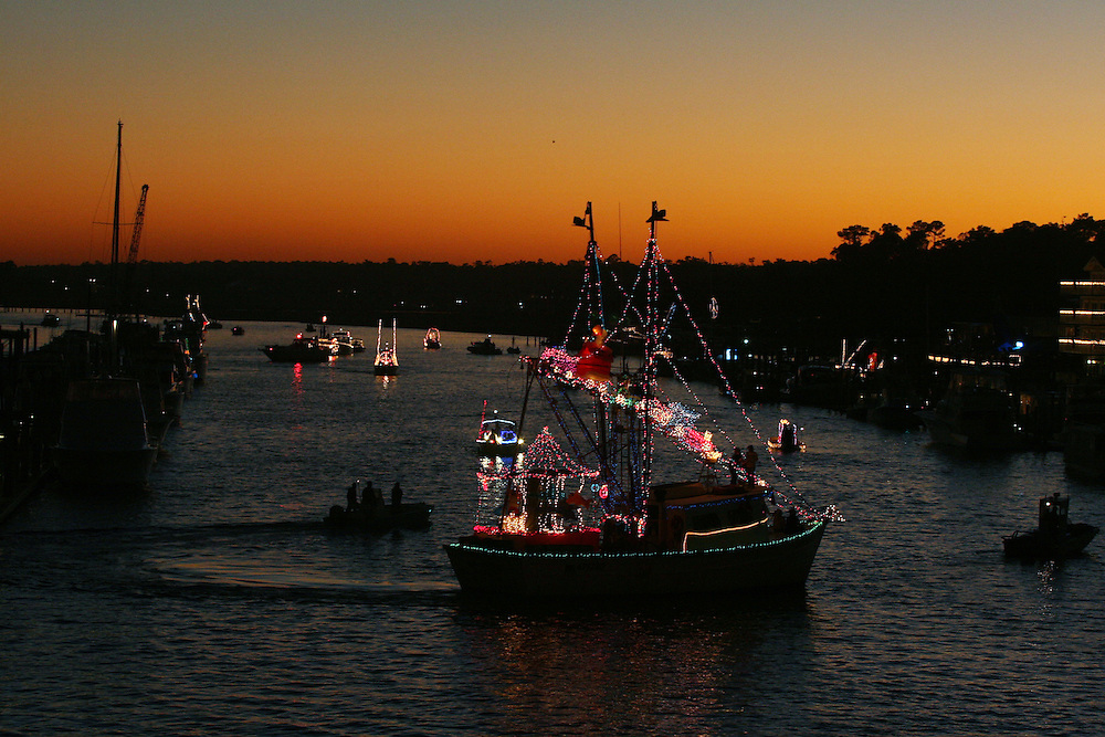 As the sun sets, boats gather in the ICW in Wrightsville Beach as the North Carolina Holiday Flotilla prepares to get underway...Photo by Logan Mock-Bunting